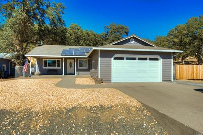 19408 Mountain Meadow Road North - Photo 1