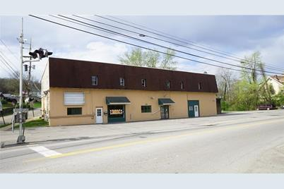 115 W Main St - Photo 1