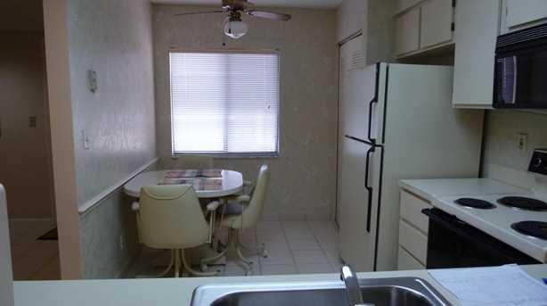 7290 Kinghurst Drive, Unit #407 - Photo 9