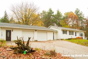 12420 16 Mile Road - Photo 1