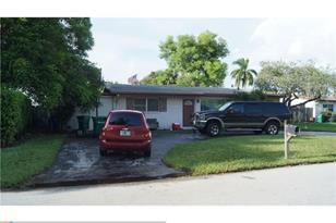 6106 NW 8th St - Photo 1