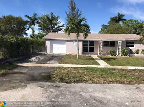 6599 NW 20th Ct - Photo 1. ‹ ›