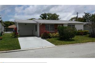 6965 NW 17th Ct - Photo 1