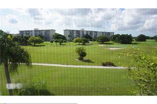 2900 N Palm Aire Dr, Unit #409 - Photo 1