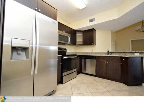 8901  Wiles Rd, Unit #305 - Photo 3