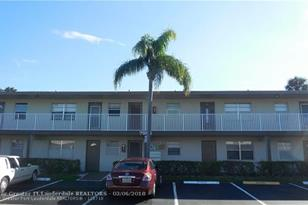 7955 NW 5th Ct, Unit #105 - Photo 1
