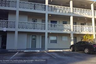 4740 NW 10th Ct, Unit #210 - Photo 1