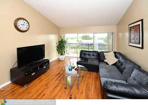 9033 Wiles Rd, Unit # 301 - Photo 1