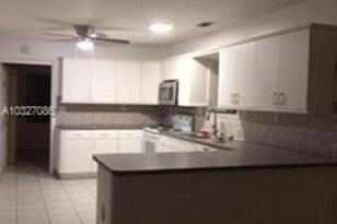 10709 SW 55th Ter - Photo 1