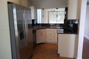 5961 NW 61st Ave #201 - Photo 1